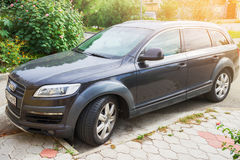 Luxury Audi Q7 parked suburbia of Sochi City at sunny day. Stock Photos