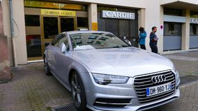 Luxury Audi A8 silver car parked in city in front of building apartment stock video footage