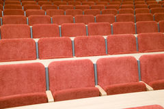 Luxury auditorium with many red chairs Stock Photos