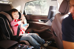 Luxury baby car seat for safety. With happy kid Stock Photo