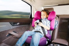 Luxury baby car seat for safety. With happy kid Royalty Free Stock Images