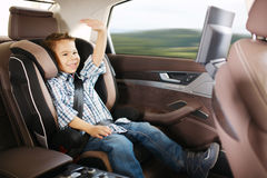 Luxury baby car seat for safety. With happy kid Stock Image