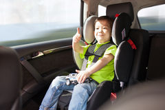 Luxury baby car seat for safety. With happy kid Royalty Free Stock Image
