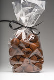 Luxury bag of chocolate truffles with black ribbon on grey Royalty Free Stock Photography