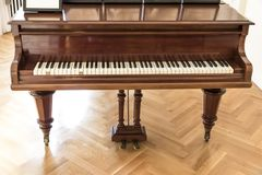Luxury ballroom with old piano. Classic palace interior. Residence in Poland stock photography