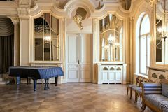 Luxury ballroom with old piano. Classic palace interior. Residence in Poland stock images