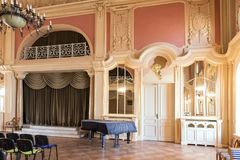 Luxury ballroom with old piano. Luxury ballroom with old piano and stage. Classic palace interior stock photos