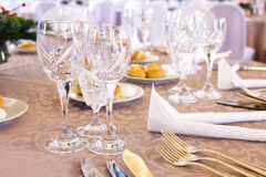 Luxury banquet table setting with crystal glasses stock photography