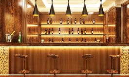 Luxury bar with drinks and bar stools. Luxury modern bar with drinks and bar stools royalty free stock photography