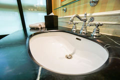 Luxury basin and faucet in bathroom Stock Photos