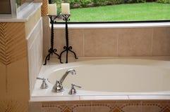 Luxury bath. Overlooking the back yard stock photo