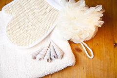 Luxury bath or shower set. With towel, glove, sponge and shells on wooden background stock photo