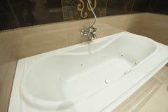 Luxury bath tub in apartment bathroom. Luxury jacuzzi bath tub in bathroom of apartment stock images