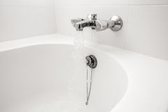 Luxury bath tub and faucet with water. Royalty Free Stock Photography