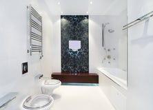 Luxury bathroom. Tv, ornamental pattern on wall royalty free stock images