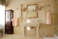 Luxury Bathroom. Large luxurious designer beige bathroom Royalty Free Stock Image