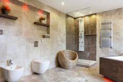 Luxury bathroom with beige tiles royalty free stock photography