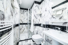 Luxury bathroom with black and white marble stock photos