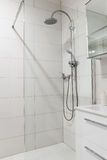 Luxury bathroom. Bright tiles and shower Stock Photo