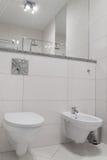 Luxury bathroom. Bright tiles  toilet and bidet Royalty Free Stock Photos