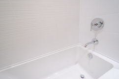 Luxury bathroom with a detail of bathtub. Fragment of luxury bathroom with a detail of bathtub Royalty Free Stock Image