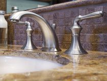 Luxury Bathroom Faucet. In model home Royalty Free Stock Photo