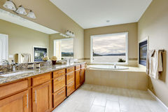 Luxury bathroom with fireplace and bay view. Royalty Free Stock Images