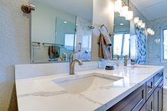 Luxury bathroom interior with blue dual washstand. Luxury bathroom interior with blue dual washstand and marble counter top royalty free stock photo