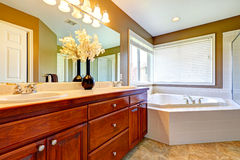 Luxury bathroom interior with corner bath tub Royalty Free Stock Image