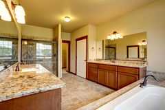 Luxury bathroom interior with granite trim and two vanity cabinets. Stock Images