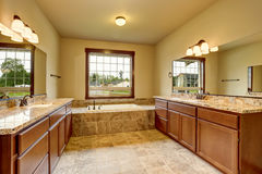 Luxury bathroom interior with granite trim and two vanity cabinets. Royalty Free Stock Image