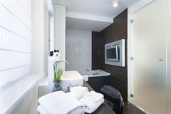 Luxury bathroom interior with wall mounted tv stock photo