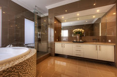 Luxury bathroom in modern home Stock Images