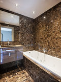 Luxury bathroom in a modern house. Interiors of a modern apartment, without furniture Stock Photo