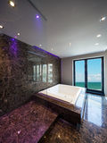 Luxury bathroom in a modern house. Interiors of a modern apartment, without furniture, sea view Stock Photos