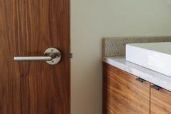 Luxury Bathroom with Open Wooden door Stock Photography