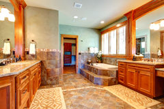 Luxury bathroom with tile wall trim Stock Photography
