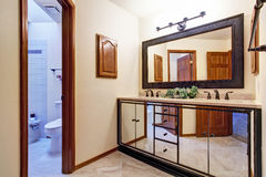 Luxury bathroom vanity cabinet in mirror trim Stock Images
