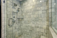 Luxury bathroom with white and grey marble and glass shower. Stock Image