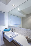 Luxury bathroom with wide mirrors and tap and sink Stock Images