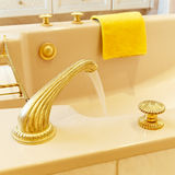 Luxury bathtub. Closeup of a vintage golden luxury bathtub Royalty Free Stock Image