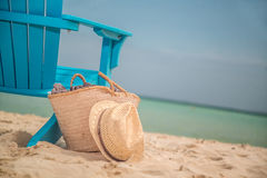 Luxury Beach Chair. A Beach Chair reserved by a bag full of luxury items to enjoy a long day at the beach stock photos