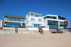 Luxury beach homes. With clear blue skys Stock Photo