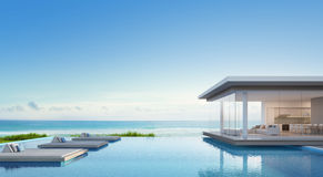 Luxury beach house with sea view swimming pool in modern design, Vacation home for big family. 3d rendering of building and swimming pool Royalty Free Stock Image