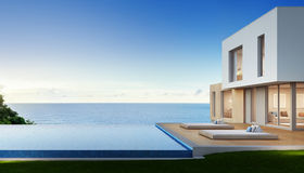 Luxury beach house with sea view swimming pool and terrace in modern design, Vacation home for big family. 3d rendering of building and swimming pool Royalty Free Stock Photography