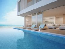 Luxury beach house with sea view swimming pool and terrace near living room in modern design, Vacation home or holiday villa. 3d rendering of building and Royalty Free Stock Image