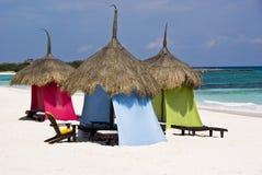 Luxury beach palapa at a Caribbean resort. Wonderful palapas on a pristine Caribbean white sand beach Royalty Free Stock Photo