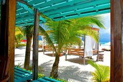 Luxury beach setting at Playa Norte on Isla Mujeres, Mexico. Playa Norte North Beach, also known as Playa Cocos and Nautibeach is very popular by tourists as the Royalty Free Stock Image
