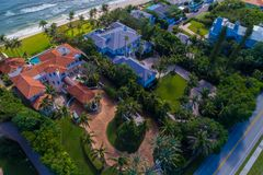 Luxury beachfront mansions in Florida. Aerial drone image of luxury beachfront mansions in Florida palm trees sand Stock Photography