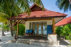 Luxury beautiful beach villa located at the tropical island. In Maldives Royalty Free Stock Images